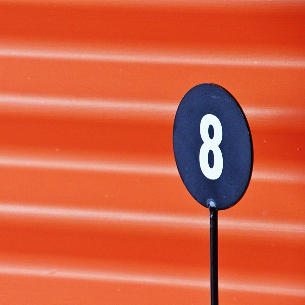 Sign of the number 8 on an orange background